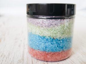 Rainbow colored bath salts in jar