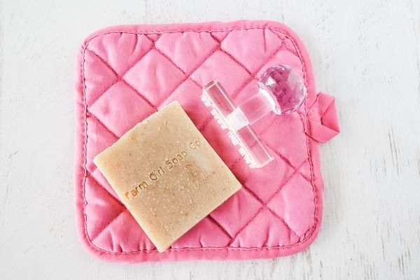 Oatmeal soap with soap stamp on a pink cloth